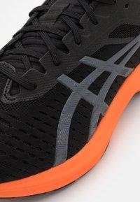 ASICS - NOVABLAST - Neutral running shoes - black/carrier grey - 5