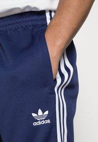 adidas Originals - Tracksuit bottoms - night sky/white - 4