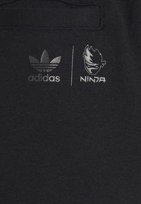 adidas Originals - NINJA PANT UNISEX - Tracksuit bottoms - black - 5