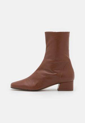DAJANI - Classic ankle boots - cognac