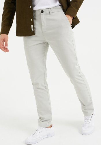 SKINNY FIT MET DESSIN - Pantalones chinos - greyish green