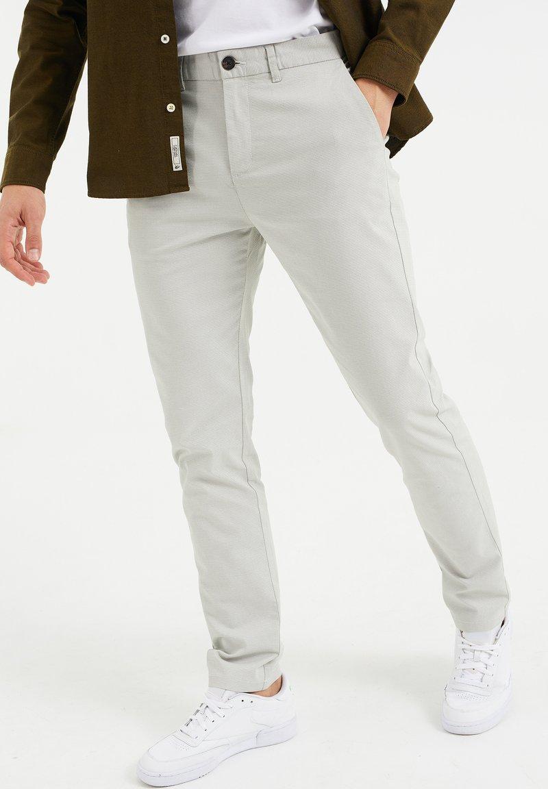 WE Fashion - SKINNY FIT MET DESSIN - Chinos - greyish green