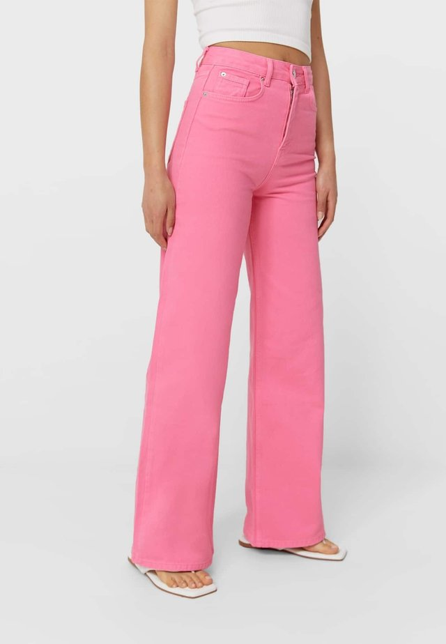 Flared Jeans - neon pink