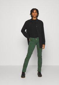 Pepe Jeans - VENUS - Trousers - bottle green - 1