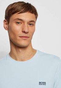 BOSS - MIX&MATCH T-SHIRT - Pyjama top - light blue - 3