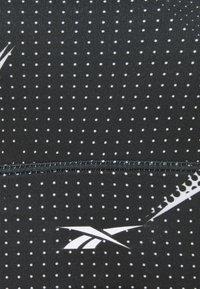 Reebok - TRI BACK BRA - Medium support sports bra - black - 2