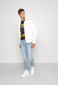 Versace Jeans Couture - Slim fit jeans - indigo - 1