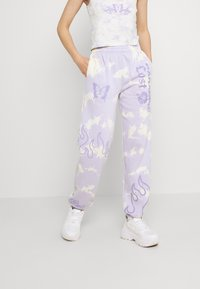 NEW girl ORDER - TIE DYE PARADISE LOST JOGGER - Tracksuit bottoms - multi - 0