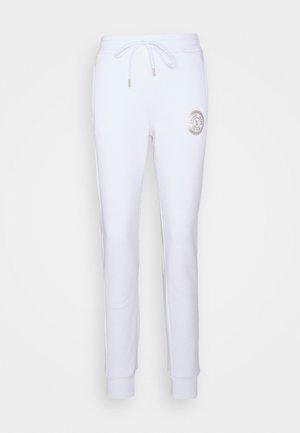 PANTS - Tracksuit bottoms - white
