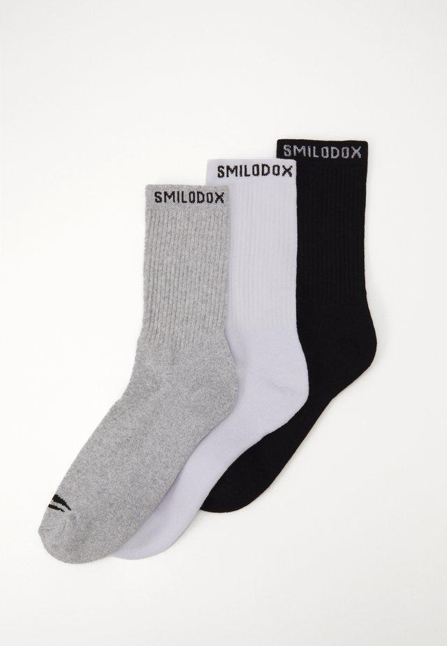 TRAINING SOCKS 3 PACK - Chaussettes de sport - schwarz/weiß
