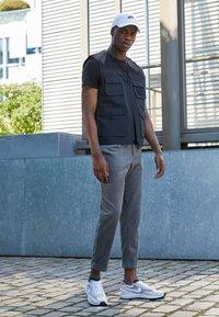 Nike Sportswear - WAFFLE ONE - Sneakers - summit white/white-black-orange - 1