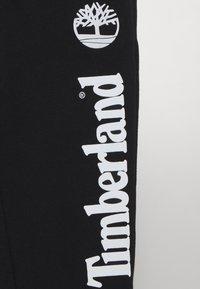 Timberland - Pantaloni sportivi - black/white - 2