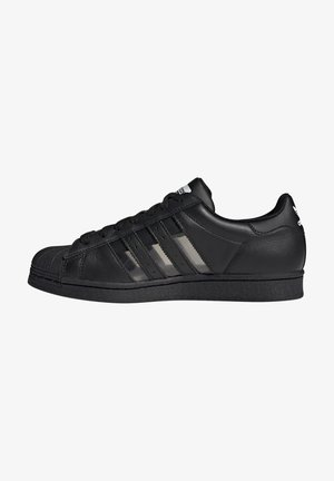 Sneakers - schwarzgold