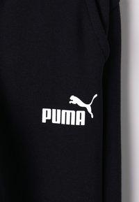 Puma - ESS LOGO SWEAT PANTS FL CL B - Pantalon de survêtement - black - 2