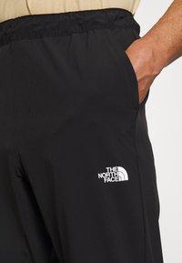 The North Face - TECH PANT - Pantalon de survêtement - black - 7