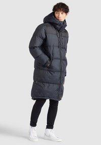 khujo - PERUN - Winter coat - schwarz print - 1