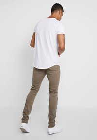 Replay - ANBASS HYPERFLEX - Jeans slim fit - brown - 2