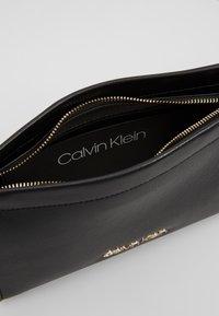 Calvin Klein - ENFOLD CROSSBODY - Across body bag - black - 4