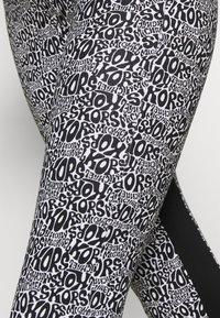 MICHAEL Michael Kors - LOGO LUX - Leggings - Trousers - white/black - 4