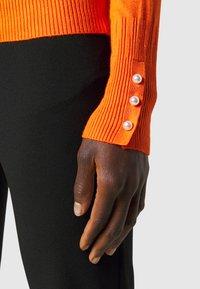 Dorothy Perkins Tall - PEARL BUTTON CUFF ROLL NECK - Jumper - orange - 5
