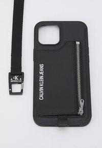Calvin Klein Jeans - PHONE CASE LANYARD COIN UNISEX - Étui à portable - black - 2