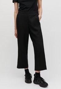 ARMEDANGELS - KAMALAA - Trousers - black - 0