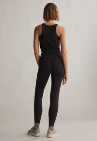 OYSHO - COMFORT - Leggings - black - 1