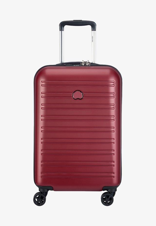 SEGUR  - Wheeled suitcase - red