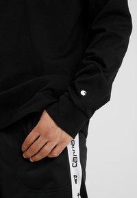 Carhartt WIP - BASE - T-shirt à manches longues - black/white - 5