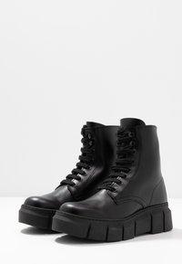 Kaltur - LOR - Platform ankle boots - black - 4