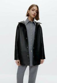 Uterqüe - Short coat - black - 0
