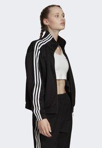adidas Originals - TRACK TOP - Trainingsjacke - black - 2
