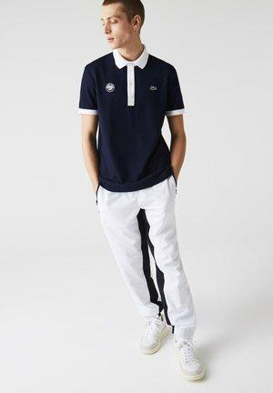 Polo shirt - navy blau  weiß