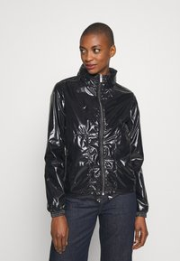 PYRENEX - PACKABLE HOOD SYLVIA - Summer jacket - black - 0