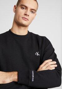 Calvin Klein Jeans - ESSENTIAL  - Felpa - black - 4