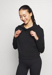Nike Performance - YOGA HOODIE - Long sleeved top - black/dark smoke grey - 0