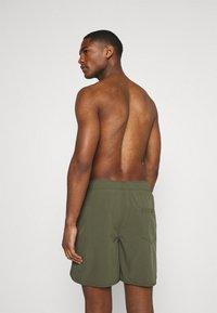 Jack & Jones - JJIFIJI JJSWIMSHORTS SOLID - Swimming shorts - dusty olive - 1