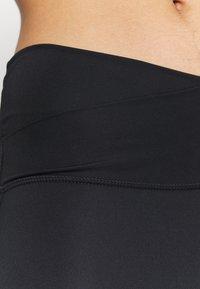 Nike Performance - YOGA CORE CUTOUT 7/8 - Leggings - black/dark smoke grey - 4
