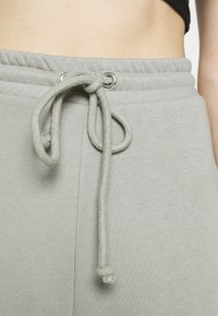 NA-KD - DRAWSTRING  - Tracksuit bottoms - grey - 4