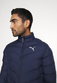 Puma - WARMCELL LIGHTWEIGHT JACKET - Winter jacket - peacoat - 3