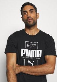 Puma - BOX TEE - Print T-shirt - black - 3