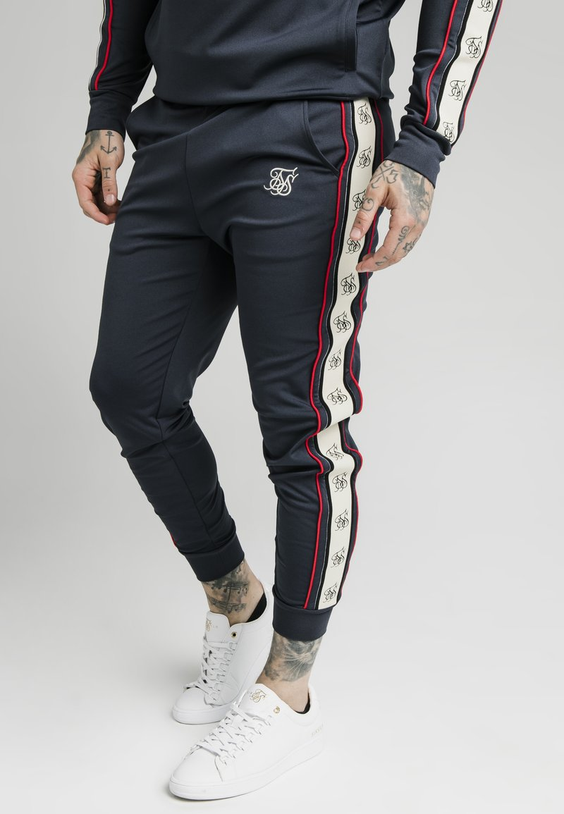 SIKSILK - PREMIUM TAPE CUFFED PANT - Tracksuit bottoms - navy