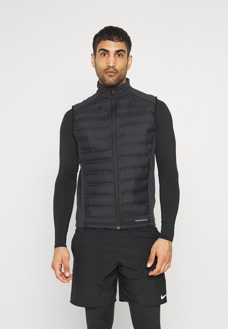Endurance - MIDAN HOT FUSED HYBRID VEST - Vest - black