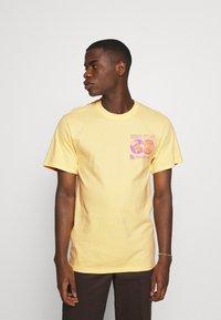 HUF - CRASH TEE - Print T-shirt - washed yellow - 0