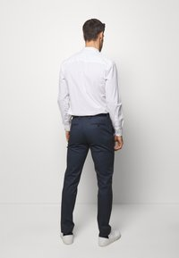 Selected Homme - SLHSLIM-AIDEN - Broek - navy blue
