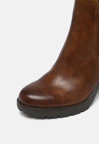 Marco Tozzi - Ankle boots - cognac antic - 7