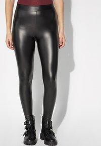 Tezenis - Leggings - Trousers - nero - 0