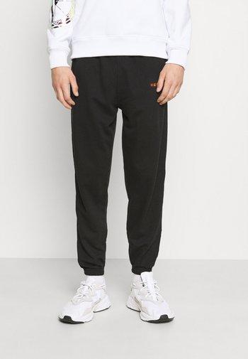 ESSENTIAL REGULAR JOGGER UNISEX - Pantaloni sportivi - black
