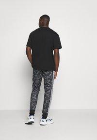 adidas Originals - GOOFY - Tracksuit bottoms - black/white - 2