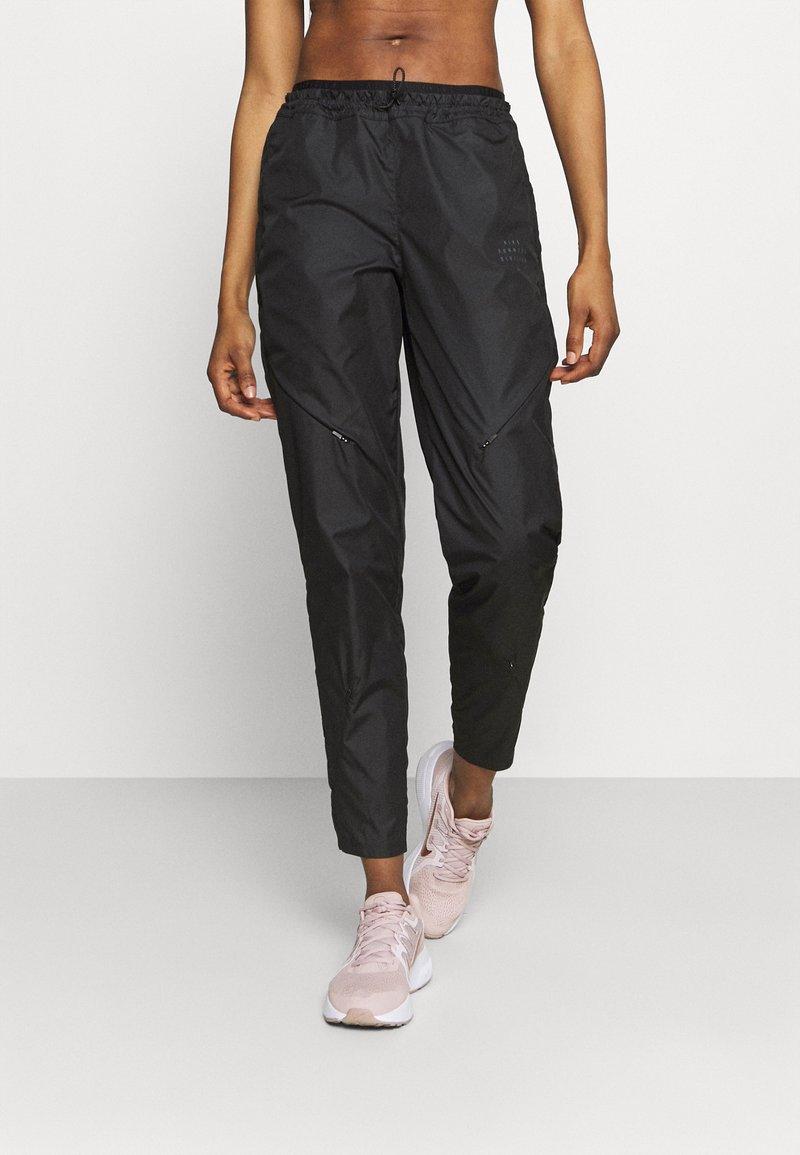 Nike Performance - RUN PANT - Pantalones deportivos - black/gold